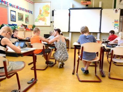 children-sitting-on-brown-chairs-inside-the-classroom-4019754